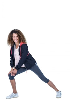Portrait of happy young woman stretching