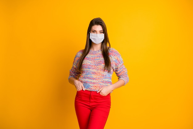 Portrait of her she attractive girl wearing gauze safety mask stop viral pneumonia problem syndrome pandemia mers cov social distance isolated bright vivid shine vibrant yellow color background