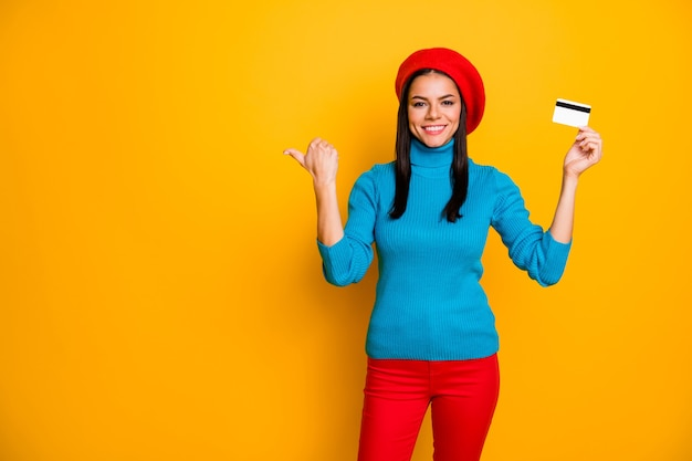 Portrait of her she nice attractive cheerful cheery girl showing atm plastic card online shopping fast shipping order service copy space isolated on bright vivid shine vibrant yellow color wall