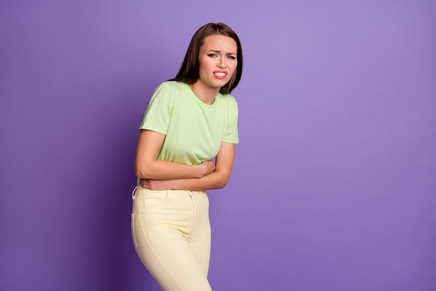 Portrait of her she nice attractive depressed ill girl suffering hugging belly indigestion pms diagnosis isolated over bright vivid shine vibrant lilac violet color background
