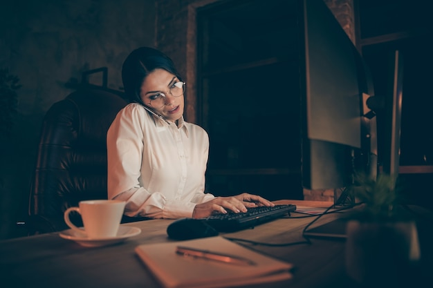 Portrait of her she nice attractive gorgeous chic lovely stylish hard-working lady expert specialist economist shark auditor attorney lawyer calling home deadline at night dark work place station