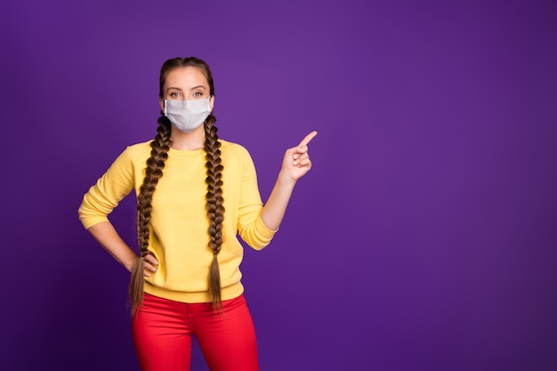 Portrait of her she nice attractive healthy girl wearing safety mask demonstrating stop contagious disease copy space isolated bright vivid shine vibrant violet purple lilac color background