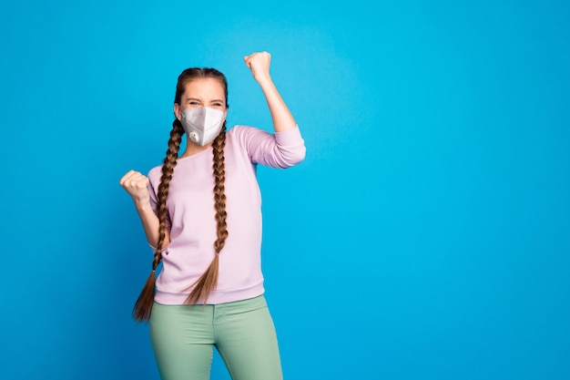 Portrait of her she nice attractive healthy lucky girl wearing safety mask celebrating disease recovery medicine life health insurance copy space isolated bright vivid shine blue color background