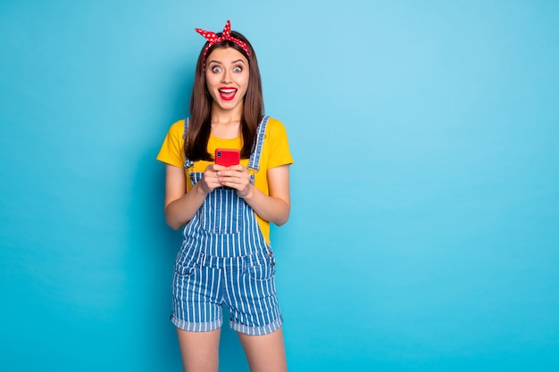 Portrait of her she nice attractive lovely glamorous cheerful cheery glad girl using cell wifi fast speed wifi isolated on bright vivid shine vibrant blue green teal turquoise color background