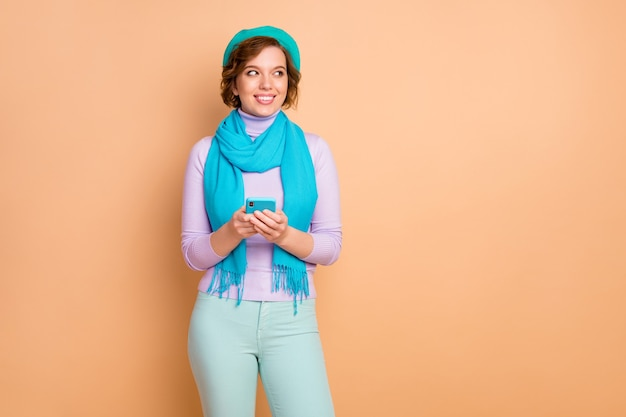 Portrait of her she nice attractive lovely pretty cute creative cheerful cheery girl using device browsing comment feedback like share isolated over beige pastel color background