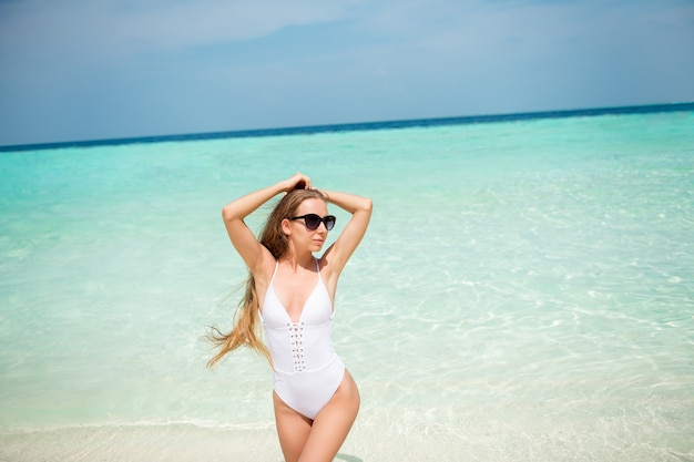 Portrait of her she nice-looking attractive lovable thin slender lady model relaxing luxury resort spa tour enjoying azure clean clear sea fresh air peaceful calm day paradise leisure