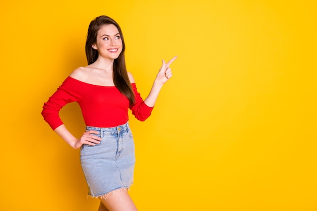 Portrait of her she nice-looking attractive lovely gorgeous cheerful cheery glad girl showing copy space ad advert solution isolated over bright vivid shine vibrant yellow color background