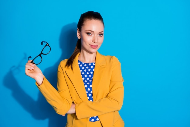 Portrait of her she nice-looking attractive pretty classy chic lady skilled experienced shark expert holding in hands specs isolated bright vivid shine vibrant blue color background