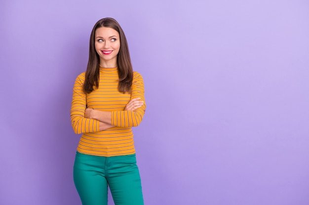 Portrait of her she nice-looking attractive winsome pretty cute lovely curious girlish feminine cheerful cheery girl thinking folded arms isolated over violet purple lilac pastel color