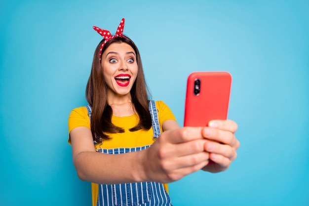 Portrait of her she nicelooking trendy fashionable attractive glamorous overjoyed girl using cell having fun time isolated on bright vivid shine vibrant blue green teal turquoise color background