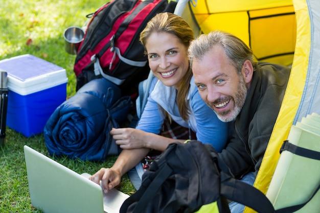 Portrait of hiker couple using laptop