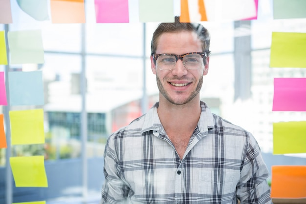 Portrait of hipster man posing in office