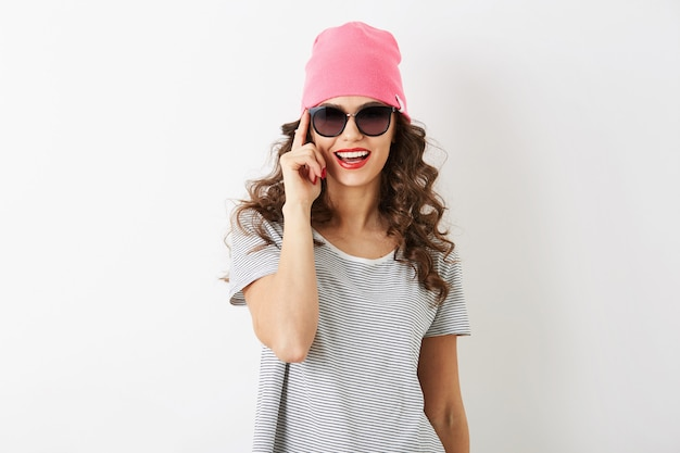 Portrait of hipster pretty woman in pink hat, sunglasses, smiling, happy mood, isolated, casual style, young student, attractive face, positive face expression, fashion accessories