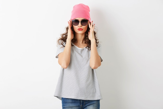 Portrait of hipster pretty woman in pink hat, sunglasses, smiling, happy mood, isolated, funny, casual style, t-shirt, summer fashion outfit