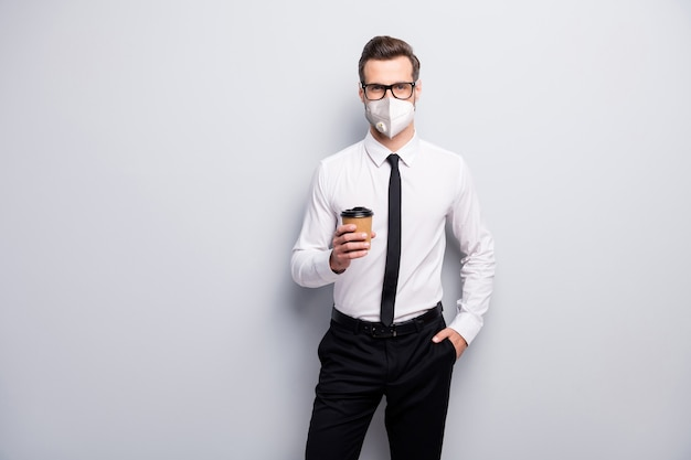 Portrait of his he corporate guy banker economist wearing safety mask stop pandemia flue grippe influenza healthcare healthy life disease prevention isolated grey color background
