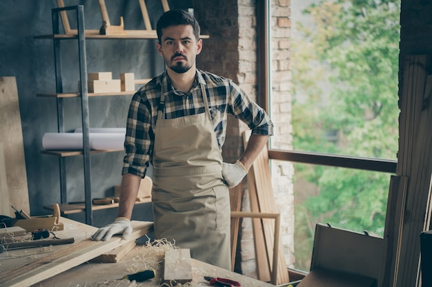 Portrait of his he nice attractive bearded serious confident successful self-employed guy specialist expert working at home studio manufacture at modern industrial loft style interior