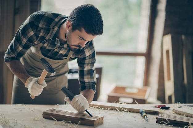 Portrait of his he nice attractive focused experienced professional guy expert specialist creating project start-up new modern home house design at modern industrial loft style interior indoors