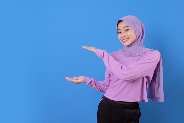 Portrait holding young lady beautiful hijab woman