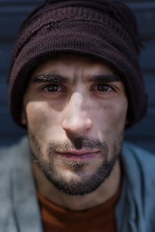 Portrait of homeless man with beautiful eyes