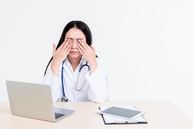Portrait images of asian attractive woman doctor is stressed and tired from hard work to take care of patients