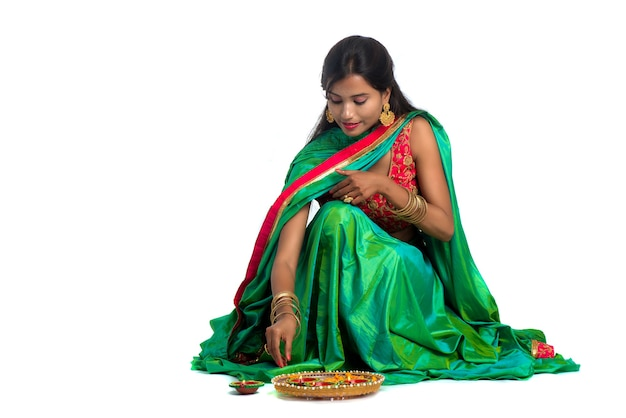 Portrait of a indian traditional girl holding diya