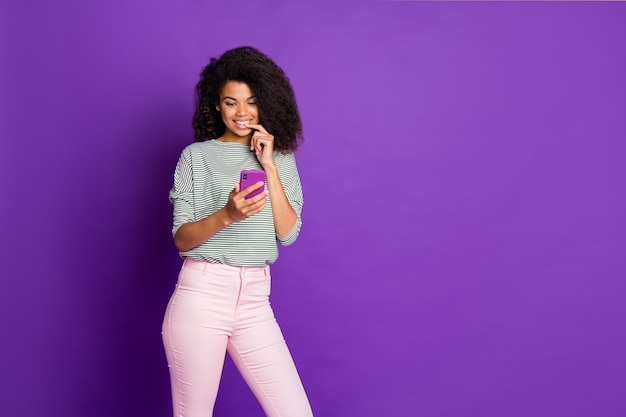 Portrait of inspired dreamy afro american girl use smart phone