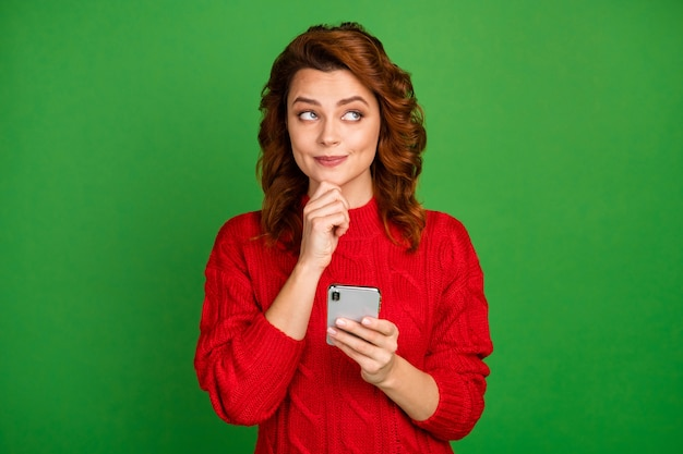 Portrait of inspired interested woman use smartphone think thoughts