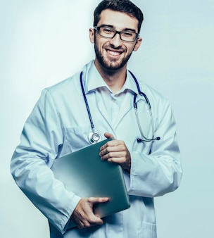 Portrait is an experienced therapist with stethoscope on white b