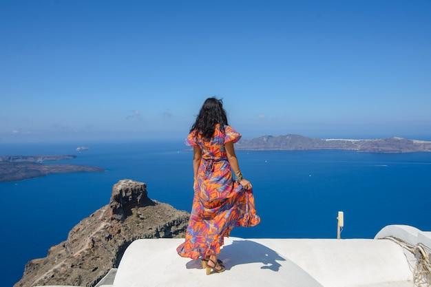 Portrait of an israeli woman. woman looking the mediterranean sea on the island of santorini.