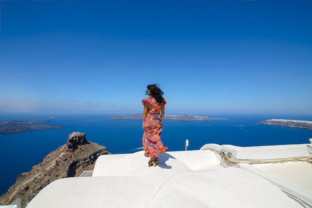 Portrait of an israeli woman. woman posing on the background of the mediterranean sea on the island of santorini.