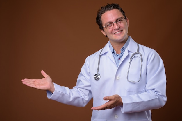 Portrait of italian doctor against brown wall