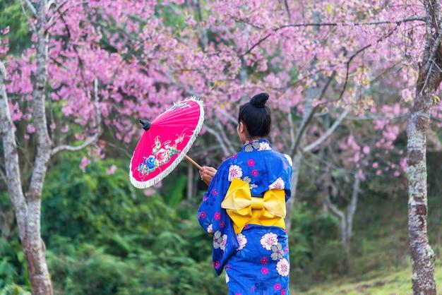 A portrait of japanese kimono woman and cherry blossom