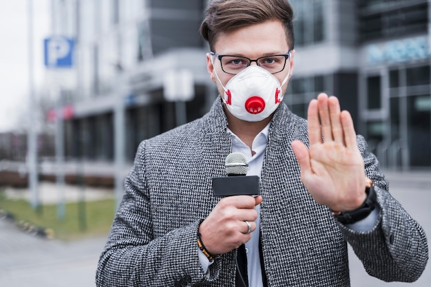 Portrait journalist man with mask working
