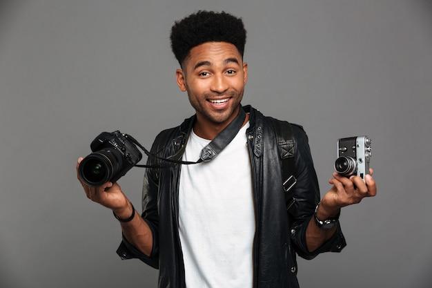 Portrait of a joyful afro american guy in leather jacket