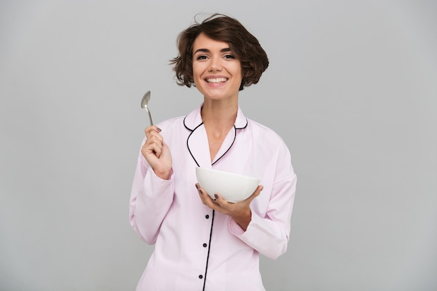Portrait of a joyful healthy woman in pajamas