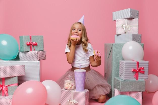 Portrait of a joyful pretty little girl in a hat