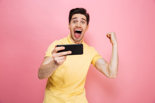 Portrait of a joyful young man playing games