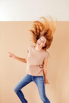 Portrait of a joyful young woman jumping