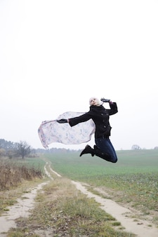 Portrait of jumping young blonde woman