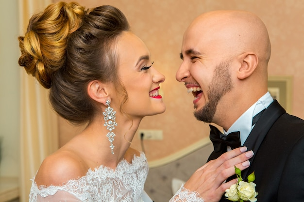 Portrait of just merried couple laughing at home
