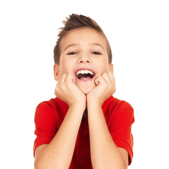 Portrait of laughing happy boy isolated on white