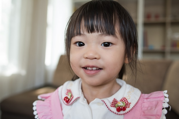 Portrait of little asian girl playing in her home