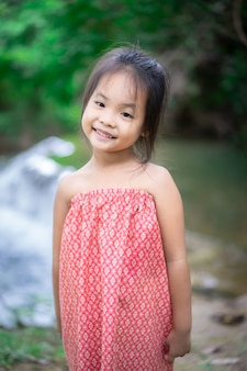 Portrait of little asian girl prepare to playing in nature water on holiday