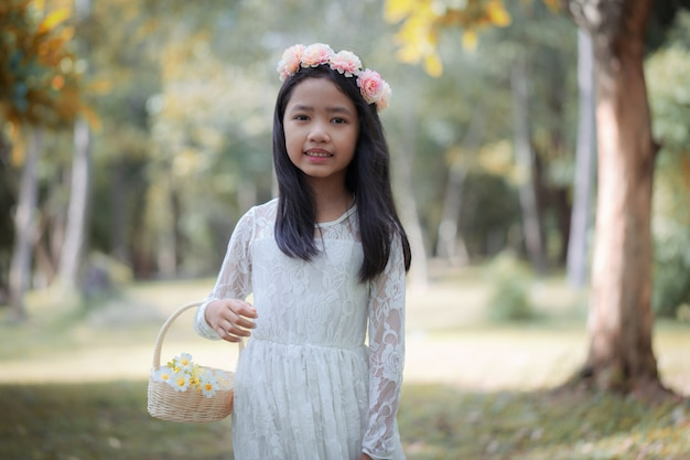 Portrait of little asian girl smiling in the nature forest