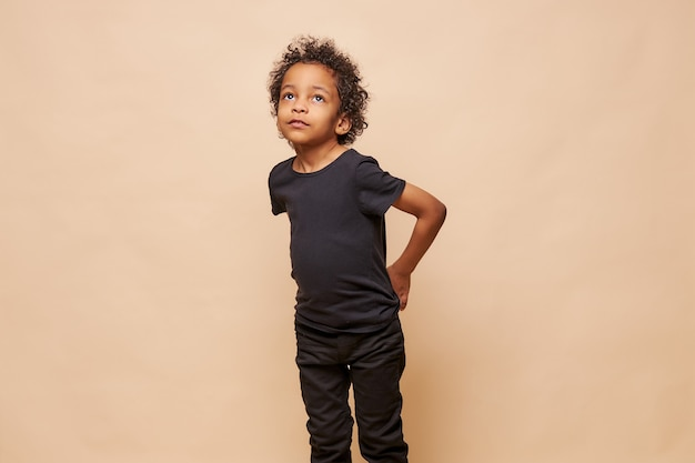 Portrait of little black afro american boy isolated