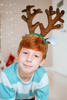 Portrait of little boy at home on christmas day