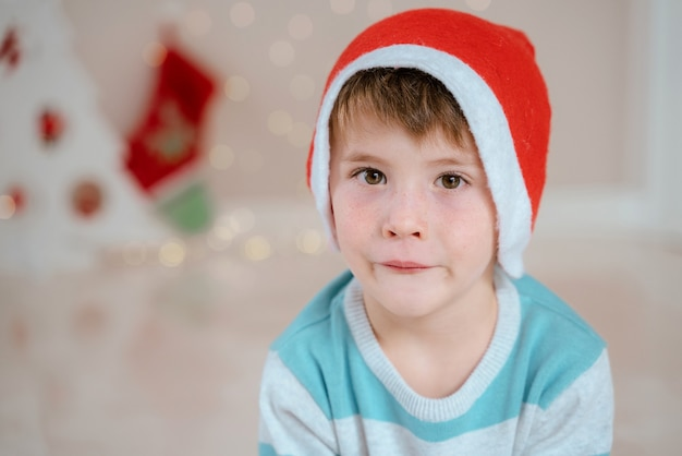 Portrait of little boy at home on christmas morning