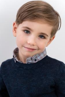 Portrait little boy wearing lens