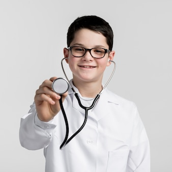 Portrait of little boy with medical stethoscope