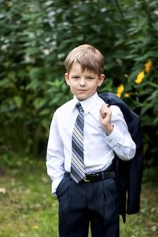 Portrait of little businessman on nature
